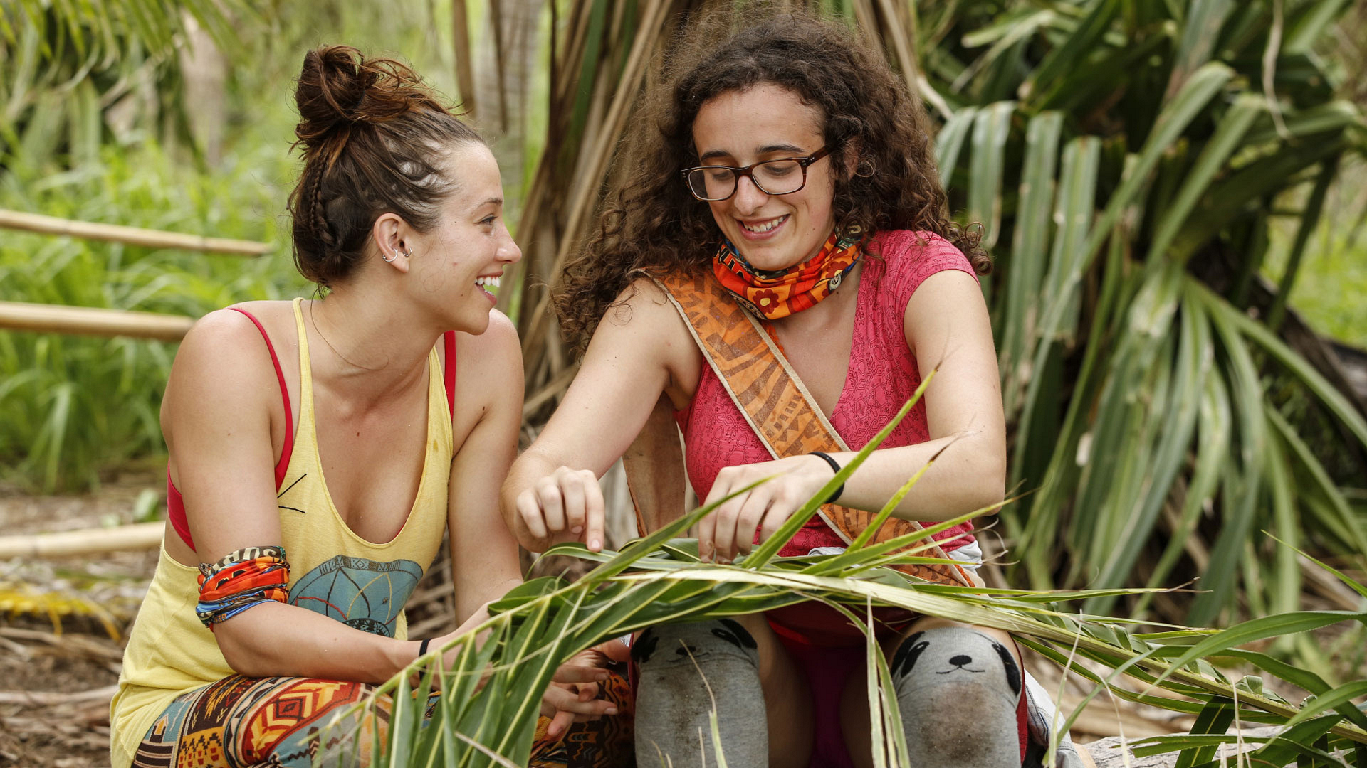 Millennials Michelle Schubert and Hannah Shapiro get to know each other while weaving fronds.