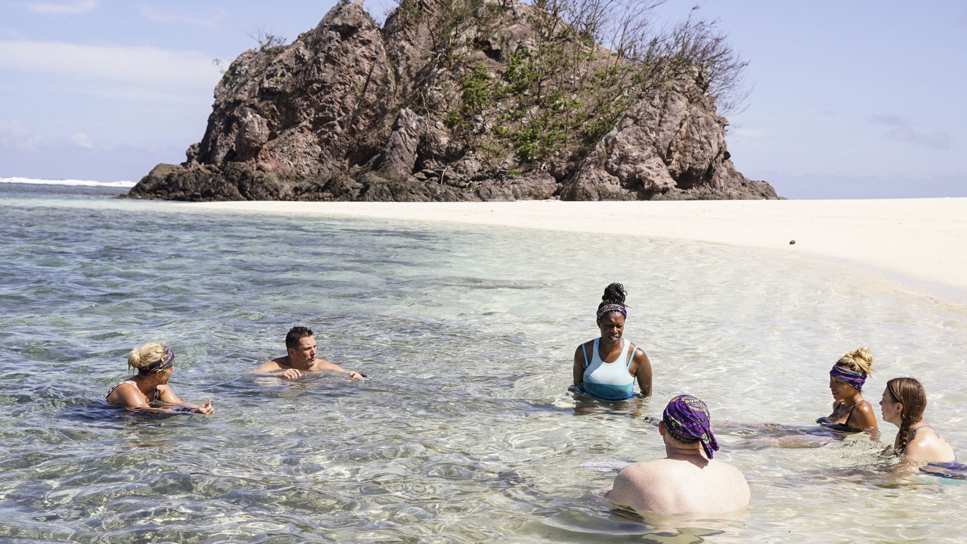 Members of the Takali Tribe take a dip in the crystal clear waters of Fiji.