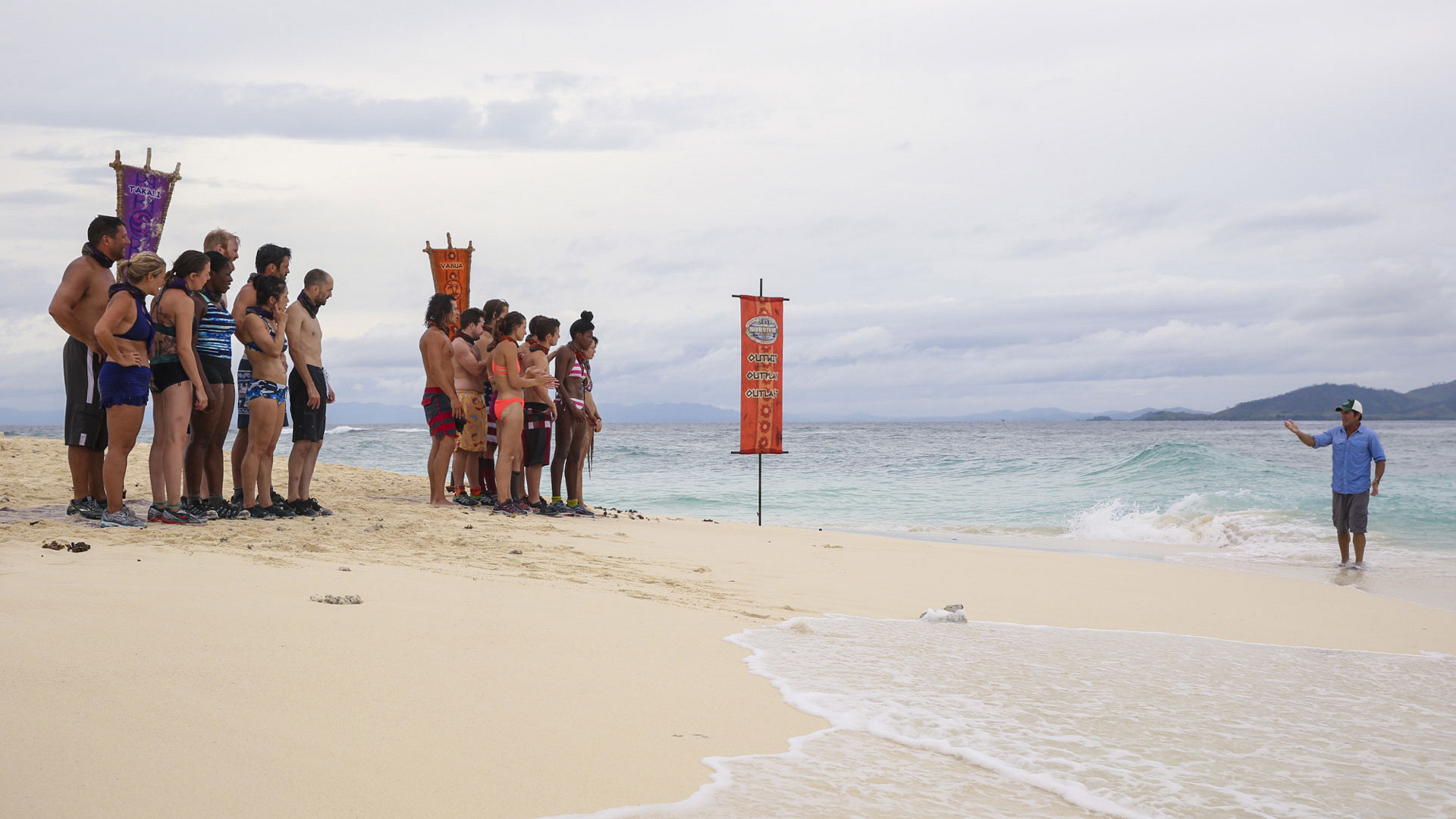Both tribes await instructions from host Jeff Probst before the first Reward Challenge takes place.