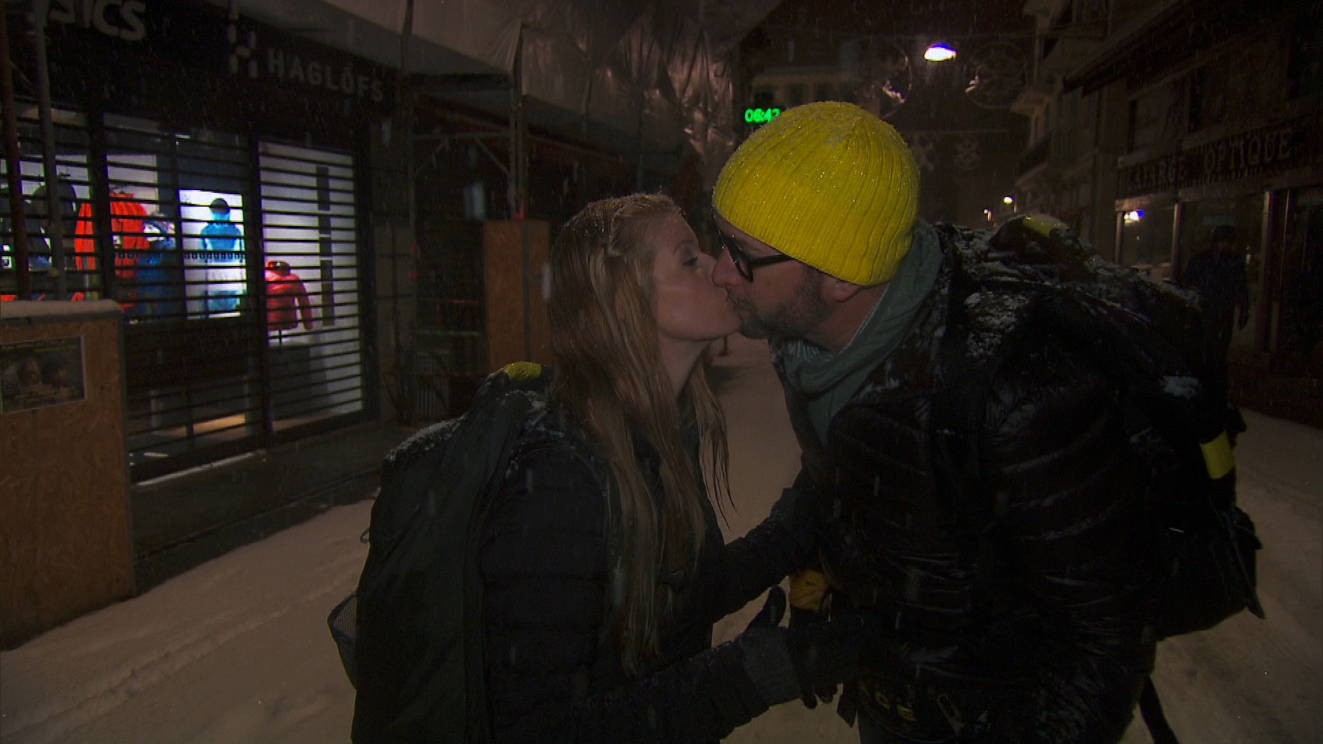 Ashley and Burnie steal a kiss during their Amazing Race adventure.