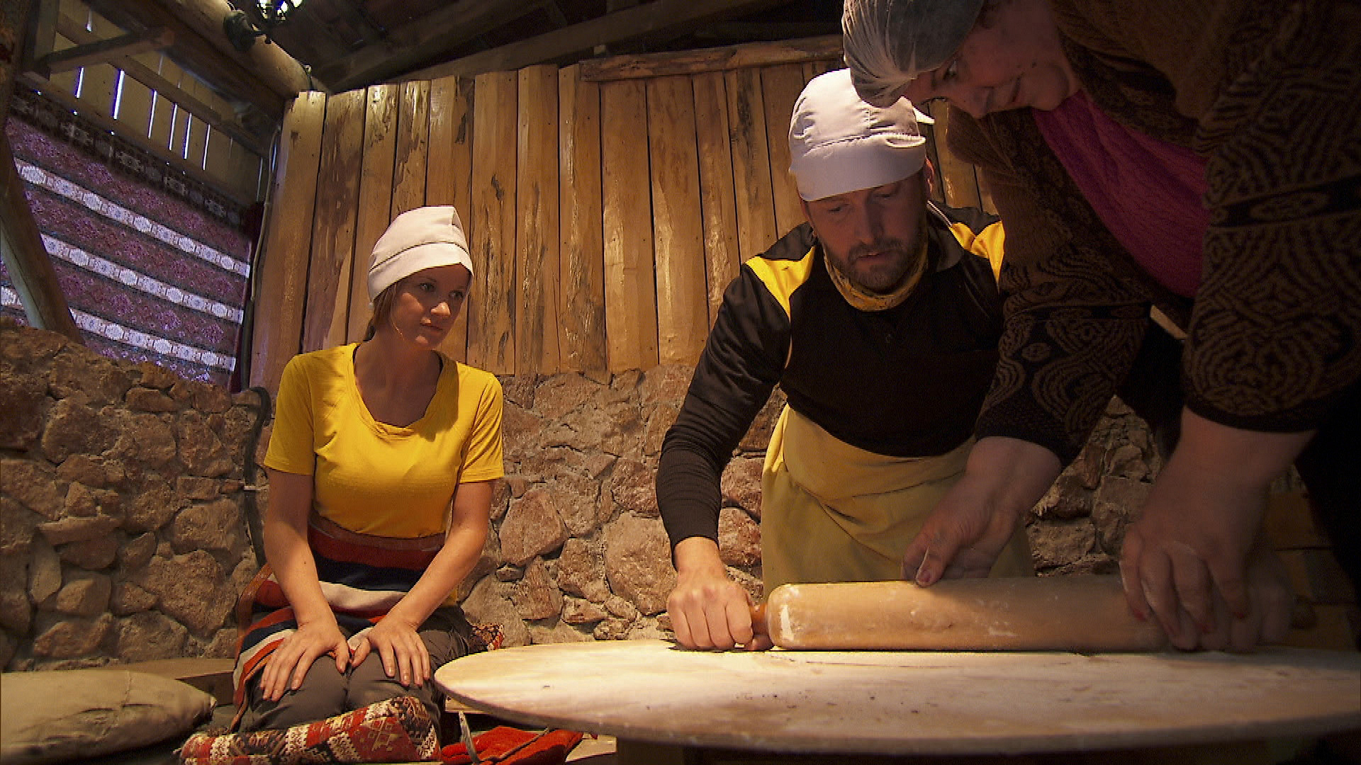 Ashley and Burnie get to work on rolling out 15 lavash breads in Armenia.