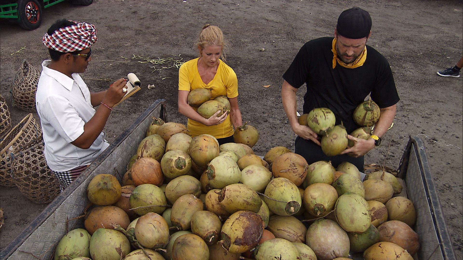 At Detour A, Ashley and Burnie are tasked with carrying 50 coconuts.