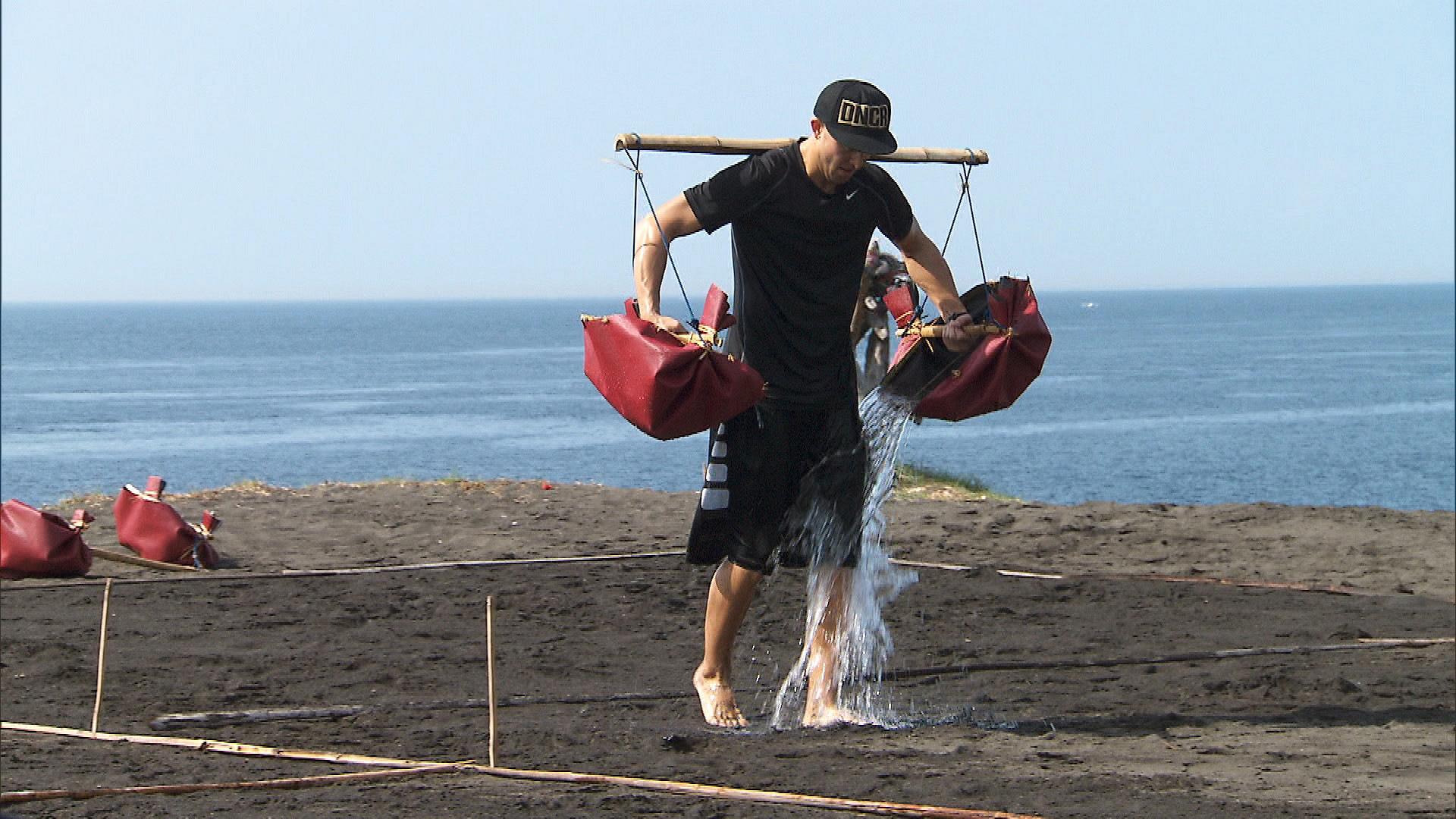 Matt helps a Balinese salt farmer by carrying water from the ocean.
