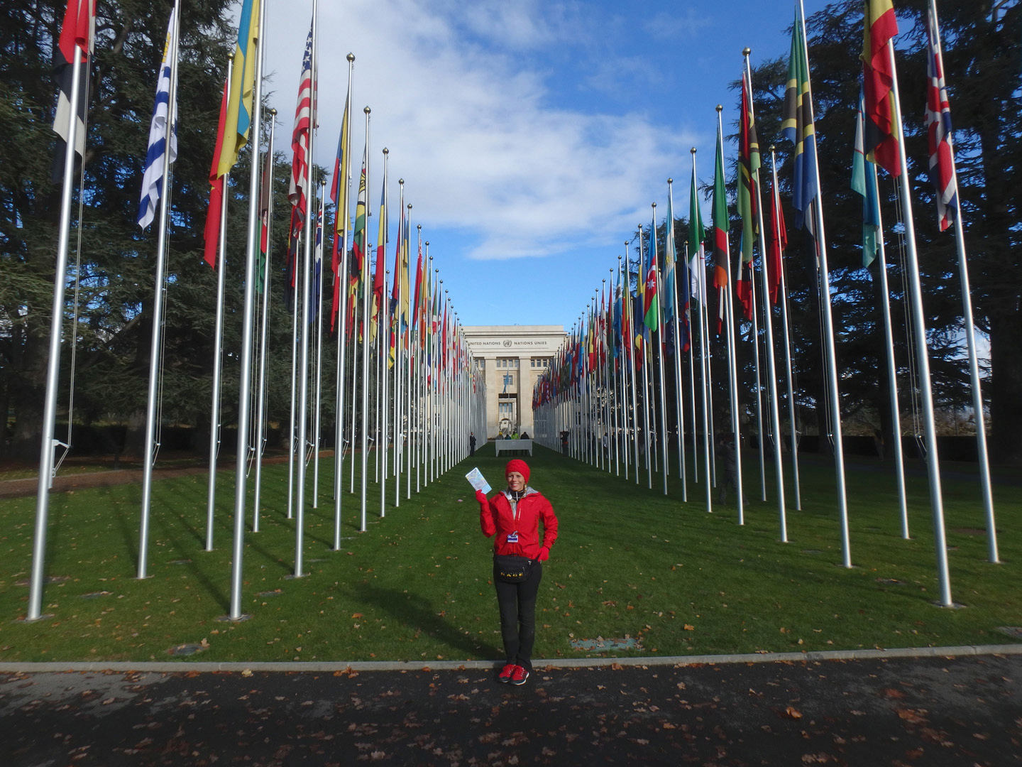 Sheri stands proudly among the flags outside the U.N. building.