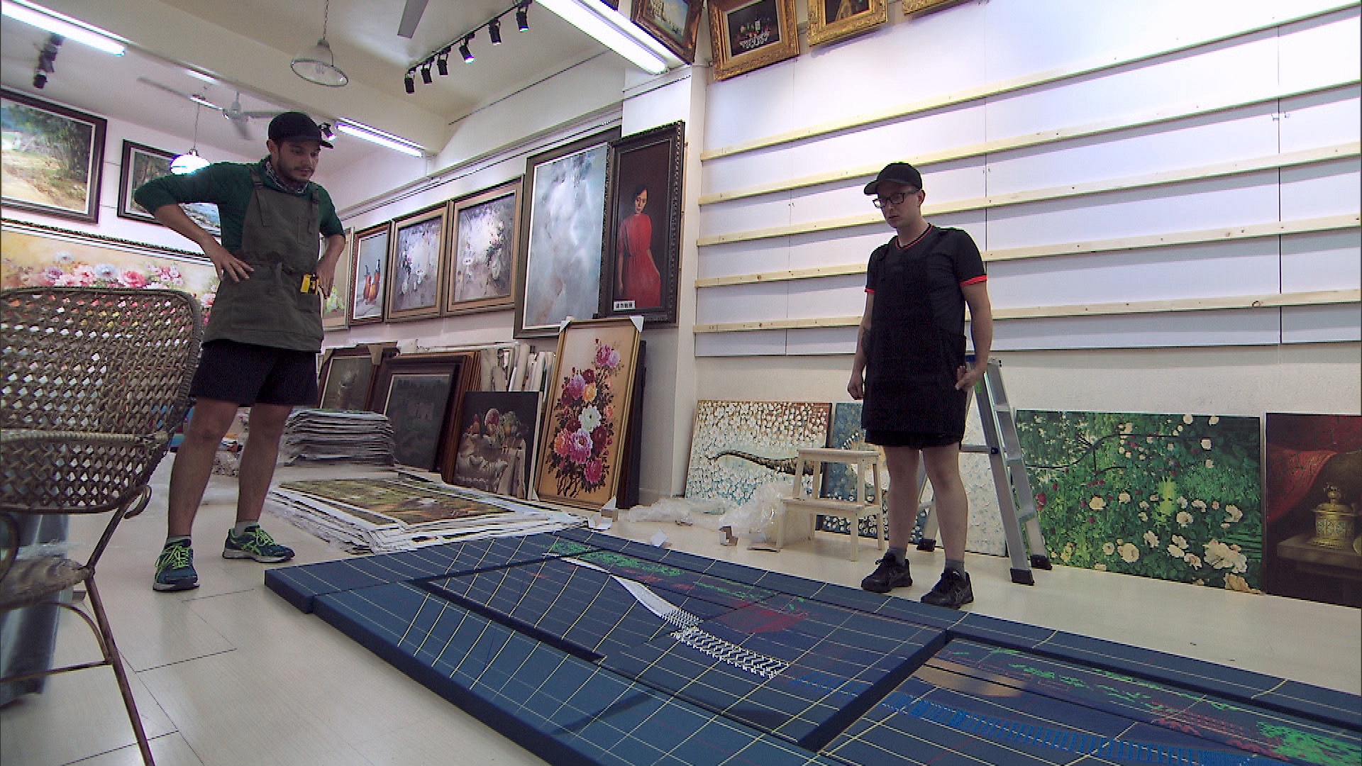 Korey and Tyler plot out the paintings before picking up a hammer.