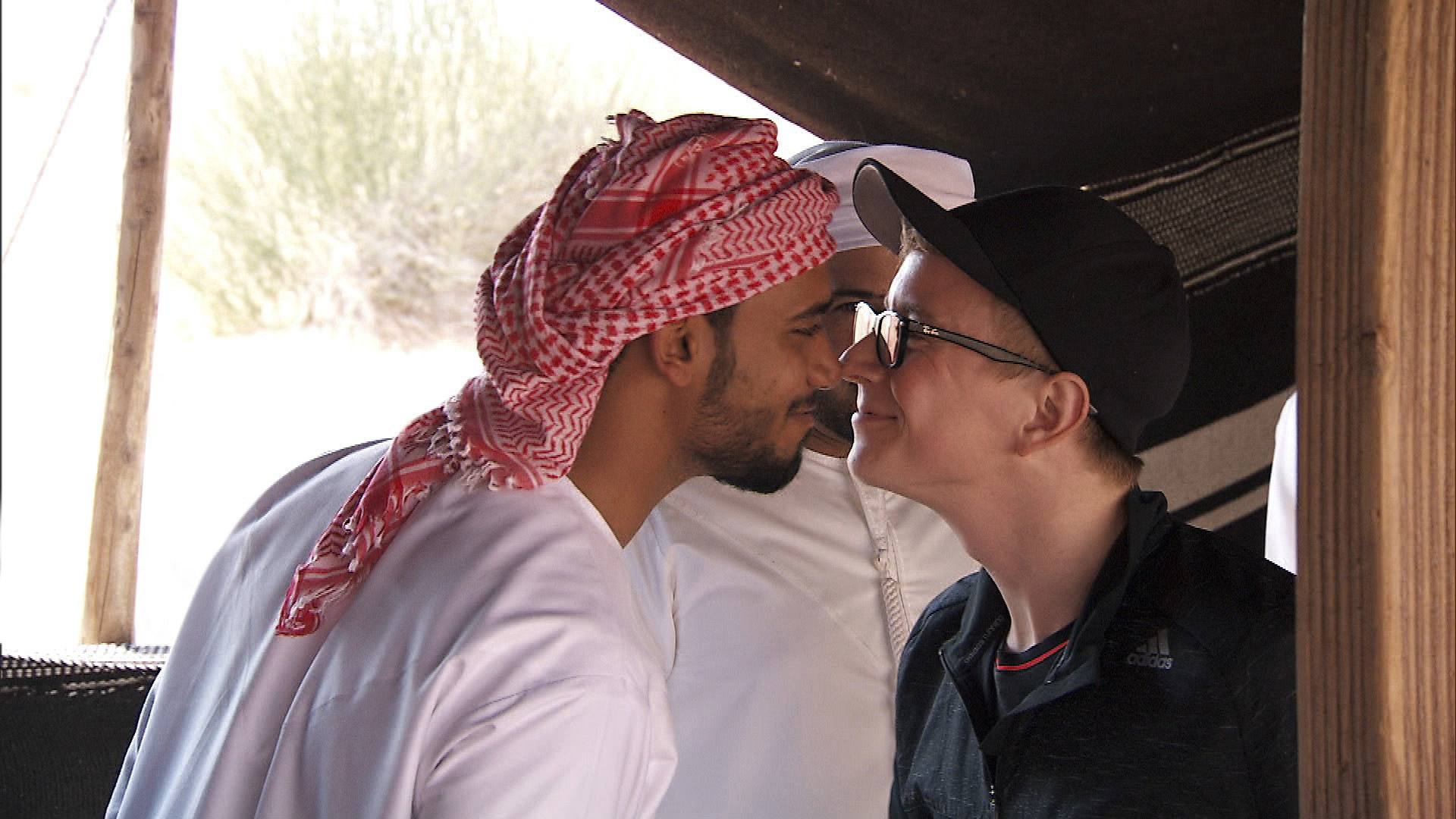 Tyler rubs noses with a local in Dubai.