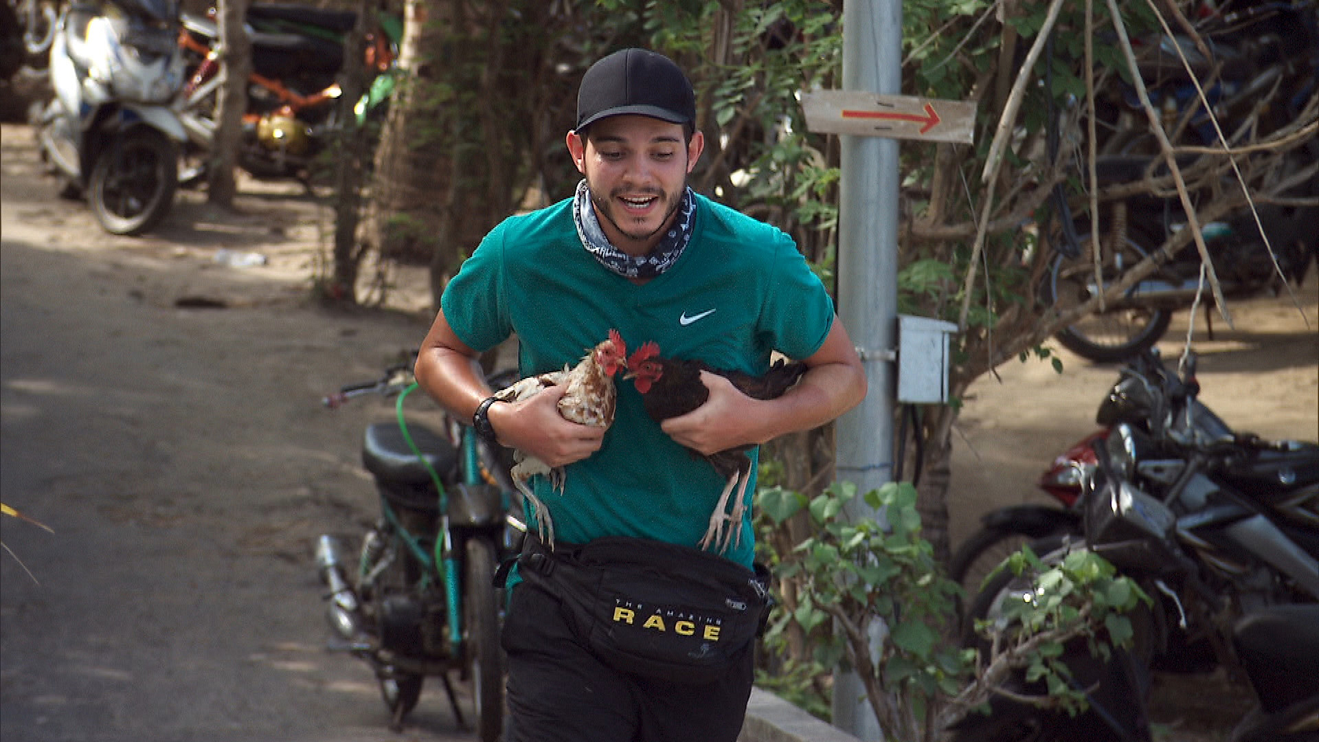At Detour A, Korey delivers chickens to the Lembongan side of the bridge.
