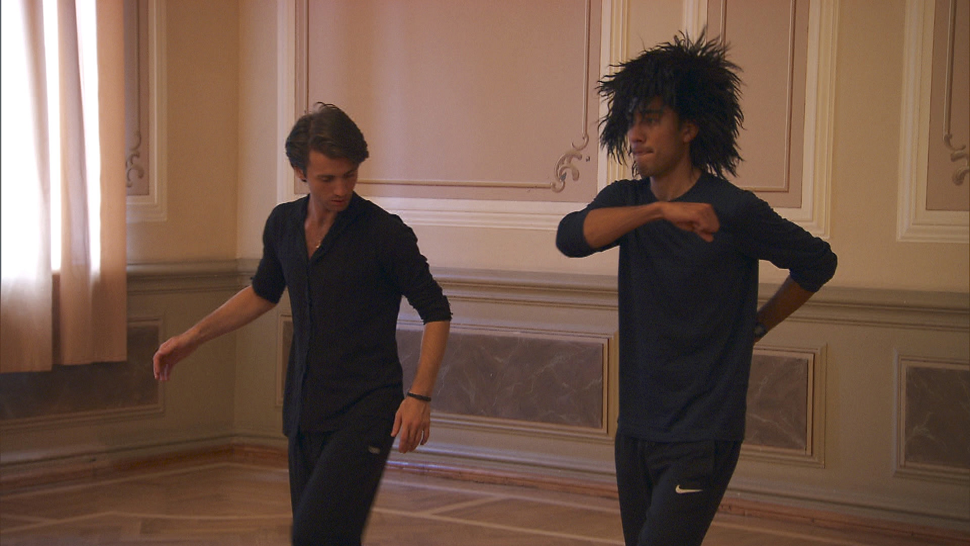 Zach dons a wig before diving into the dance challenge.