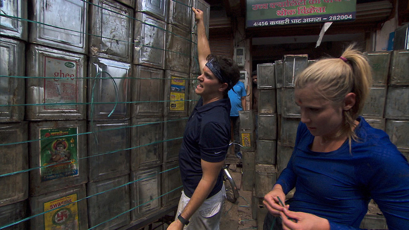 In Detour A, Joey (left) and Kelsey (right) must load up a cargo rickshaw with 120 cans.