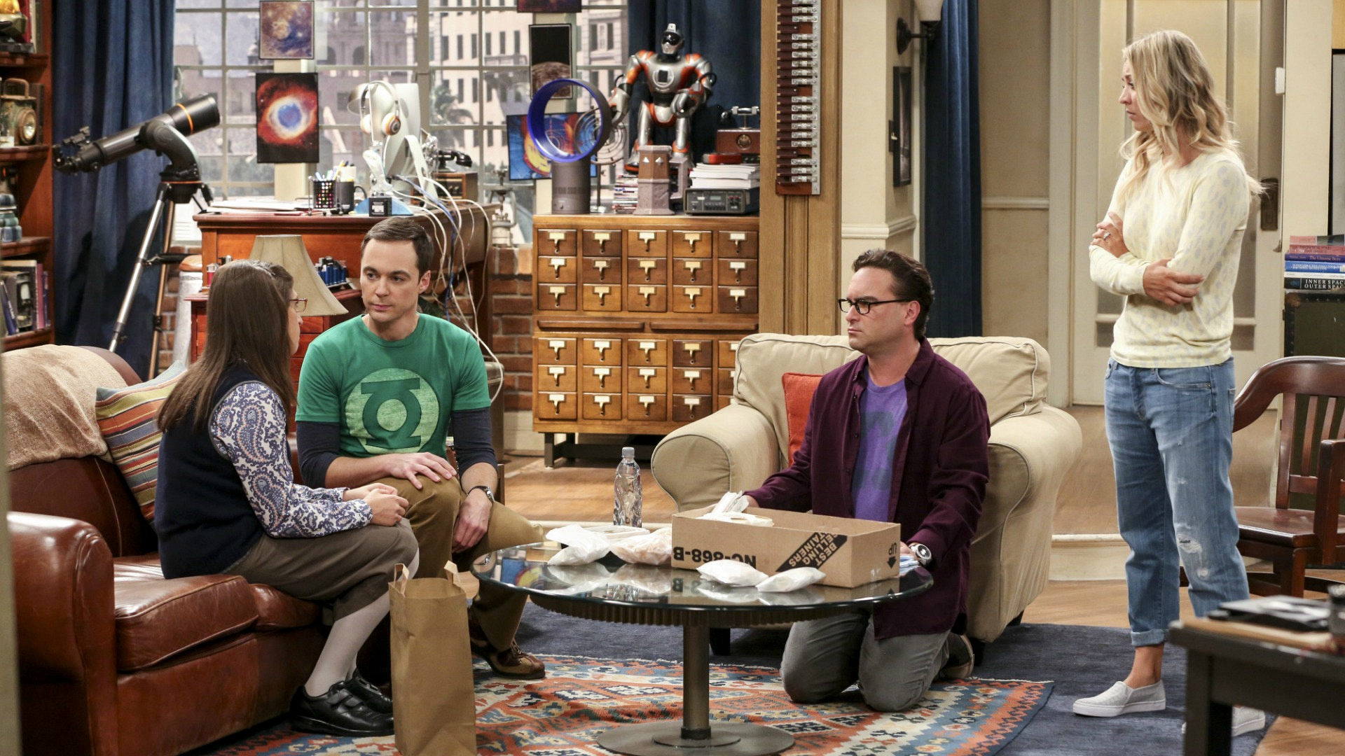 Leonard and Penny watch as Sheldon and Amy discuss a dicey topic.