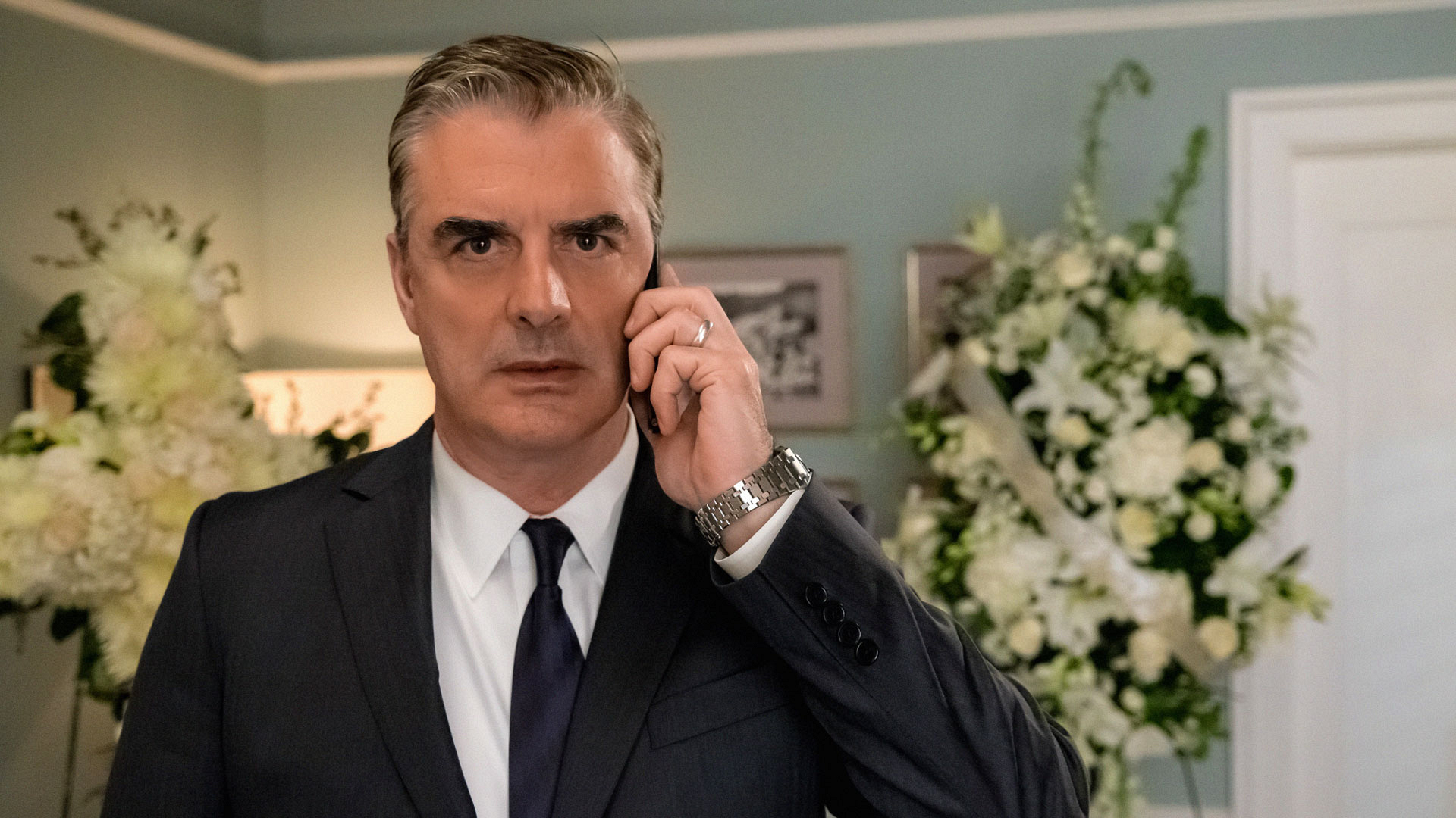 Peter Florrick receives a phone call.