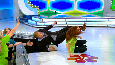 Watch Drew Carey Get (Almost) Knocked Offstage By An Enthusiastic Contestant